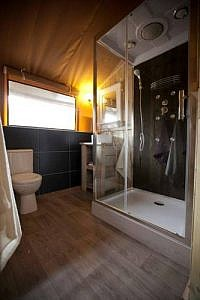 Private shower and toilet in a Safari tent with sanitary